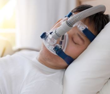man sleeping CPAP machine with